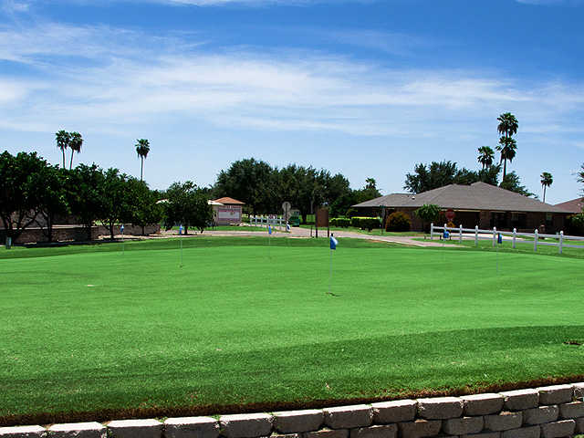 A view of the clubhouse and practice putting green at Howling Trails Golf Course.