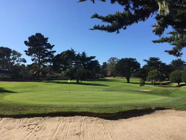 A sunny day view of a hole at Pacific Grove Golf Links.