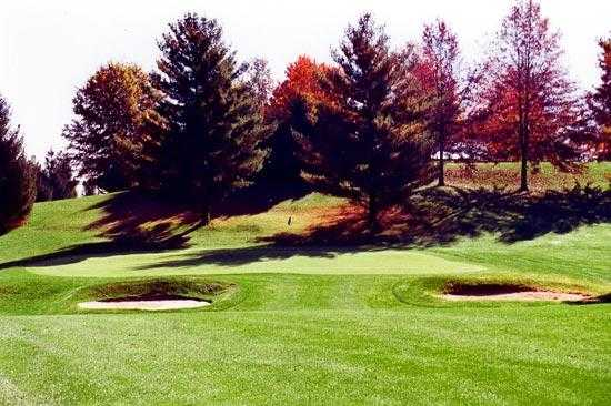 A view of green protected by bunkers at Pine Hill Golf Course