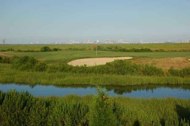 A view over the water of a green at Atlantic City Country Club.