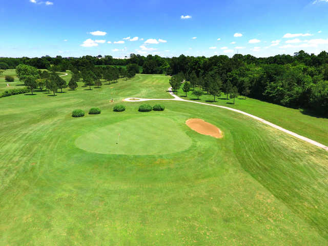 A sunny day view of a green at St. Genevieve Golf Course.