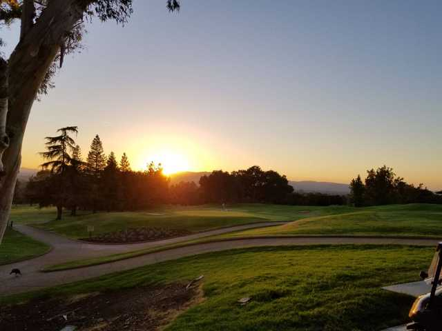 A sunset view of a green at Boundary Oak Golf Course.