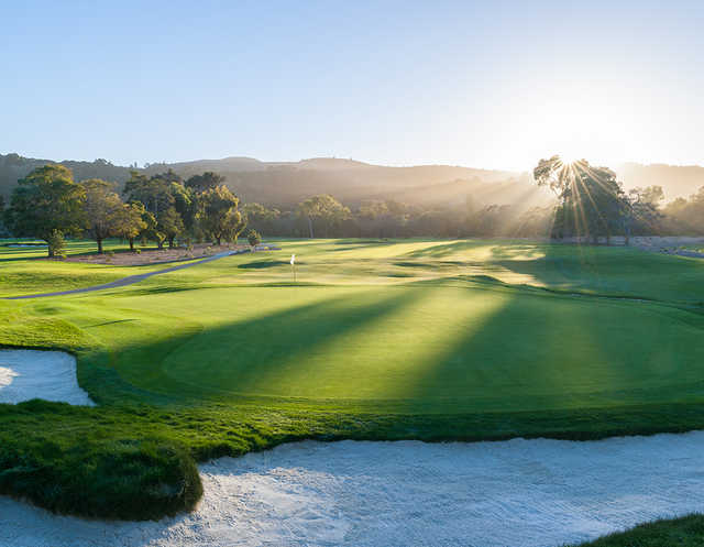A sunny day view of a hole at Quail Lodge Resort & Golf Club.