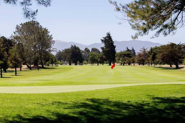 A sunny day view of a hole at Salinas Fairways Golf Course.