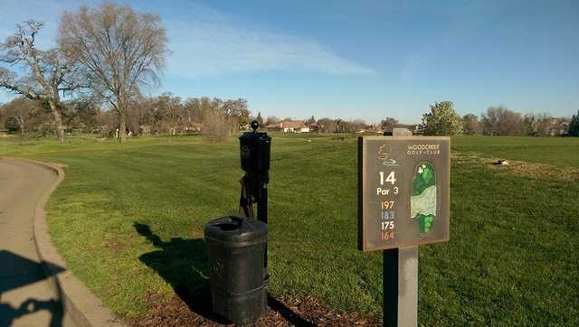 A view from the 15th tee sign at Woodcreek Golf Club.