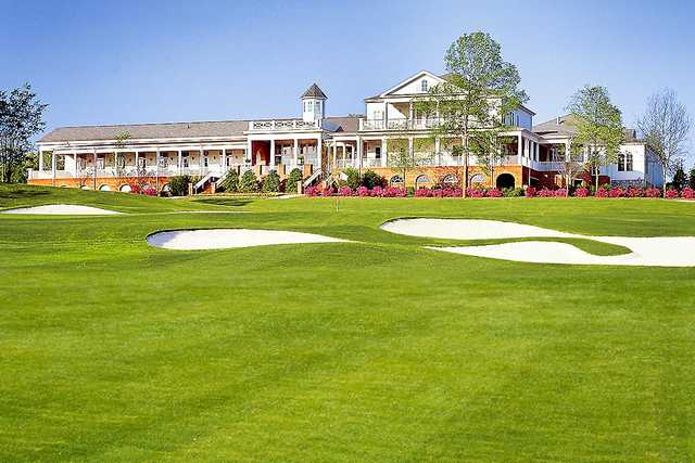 A view of a hole and the clubhouse at Georgia Club.