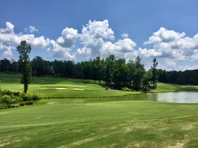 A sunny day view of a hole at Chestatee Golf Club.