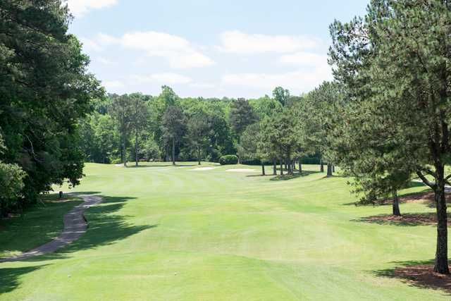 A sunny day view of a fairway at RiverPines Golf Course.