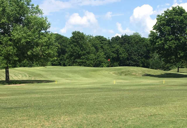 A sunny day view of a hole at Sapulpa Golf Course.