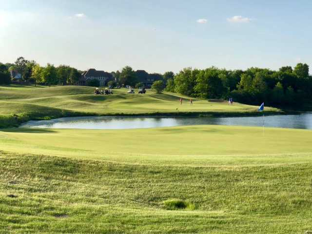 A sunny day view of a green at White Hawk Golf Club.