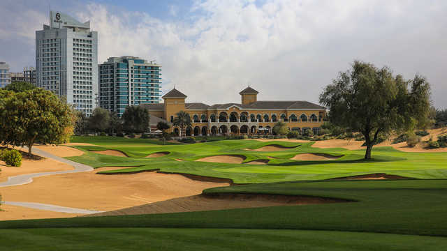A view of a well protected hole and the clubhouse in background from The Els Club at Dubai Sports City.