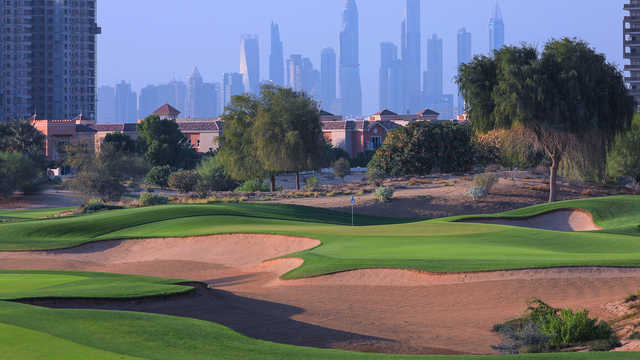 A sunny day view of a green from The Els Club at Dubai Sports City.