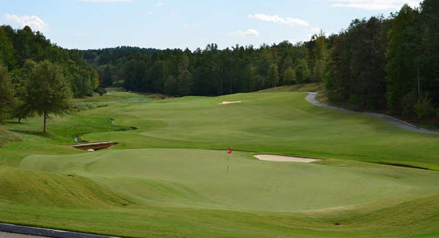A sunny day view of a green from The Cliffs at Keowee Falls Golf Course.