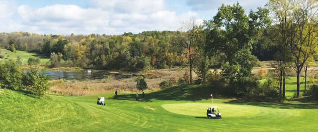 A sunny day view of a hole at Irish Hills Golf Course & Valley Resort.
