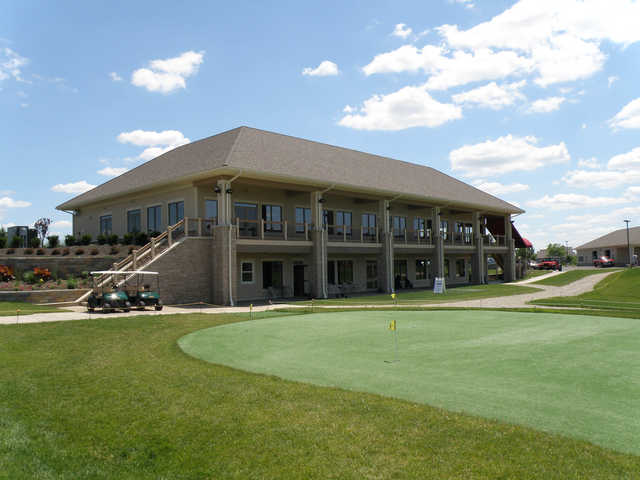 A view of the clubhouse with putting green in foreground at Little Bear Golf Club