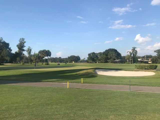 A view of a green protected by a bunker at Seminole Lake Country Club.