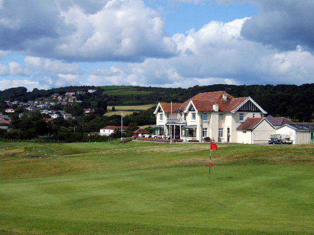The 18th green and the clubhouse at Ashburnham Golf Club.