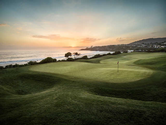 A sunset view of a green at Monarch Beach Golf Links.