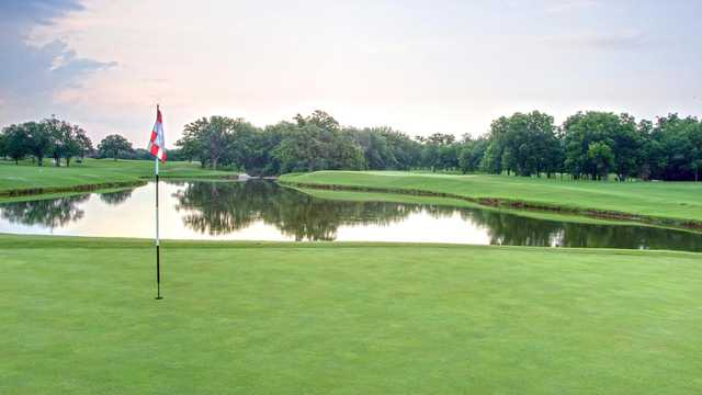 A view of a green with water coming into play at Sky Creek Ranch Golf Club.