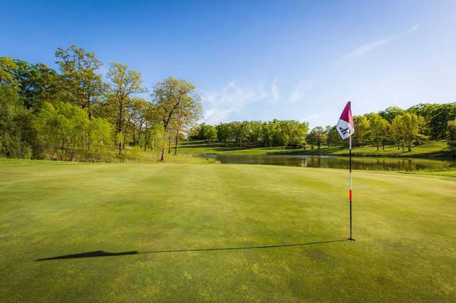 A spring day view of a hole at Indian Rock Golf Club.