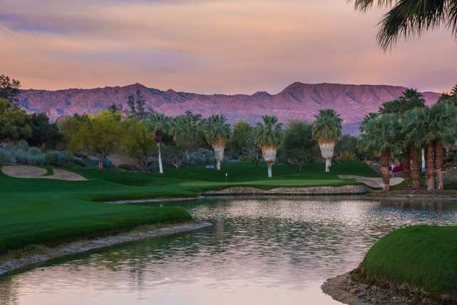 A sunset view of a green at Desert Course from The Vintage Club.