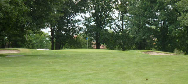 A view of a green flanked by bunkers at Summertree Golf Course.