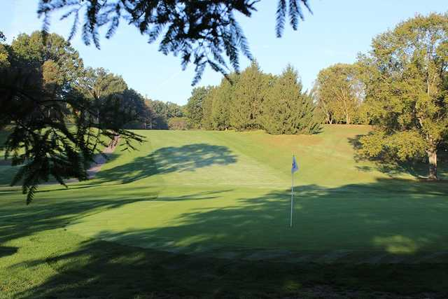 A sunny day view of a hole at Yankee Run Golf Course.