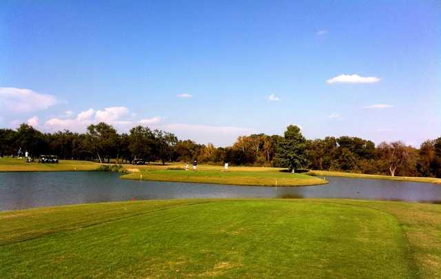 The par-4 sixth hole on Austin's Jimmy Clay Golf Course has an island green