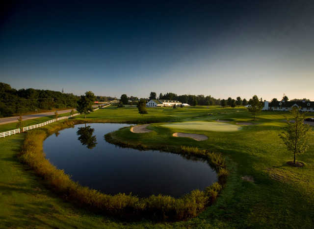 A view of a green with bunkers and water coming into play at Manistee National Golf & Resort.