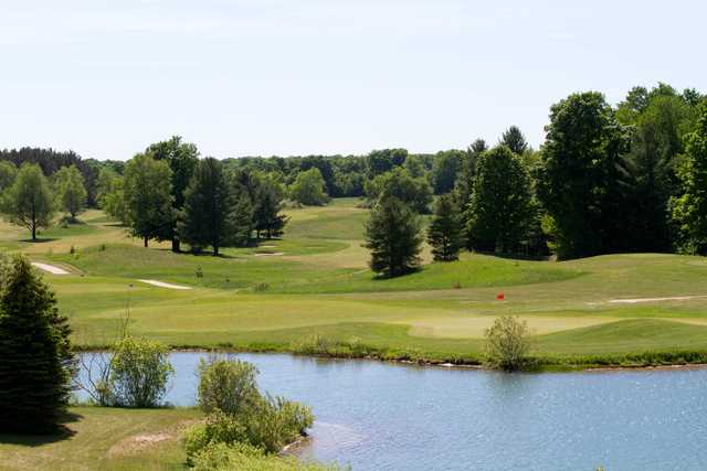 A view of a green with water coming into play at Mistwood Golf Course.