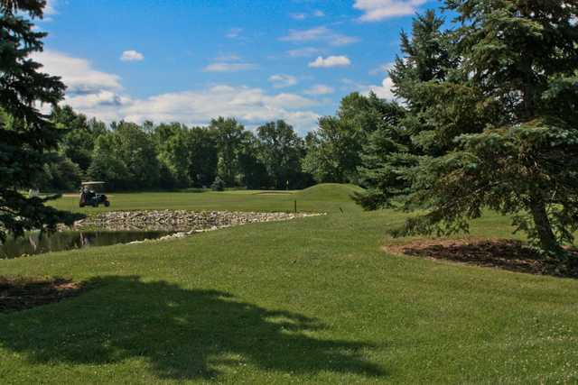 A sunny day view of a hole at Winding Creek Golf Course.