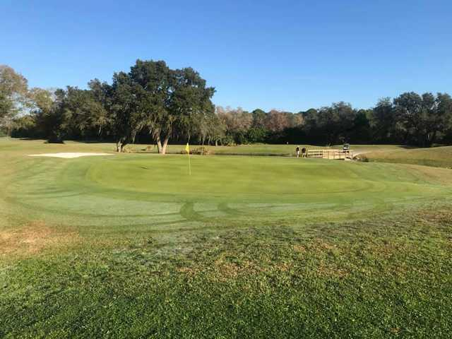 A sunny day view of a green at Charlotte Harbor National Golf Club.