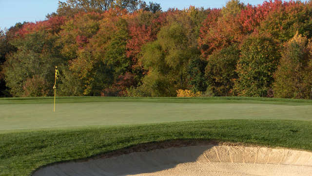 A fall day view of a hole at Colts Neck Golf Club.
