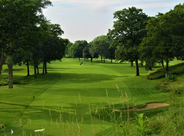 A sunny day view of a fairway at Racine Country Club.
