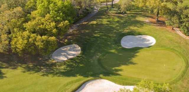 Aerial view of a green protected by bunkers at Avila Golf & Country Club