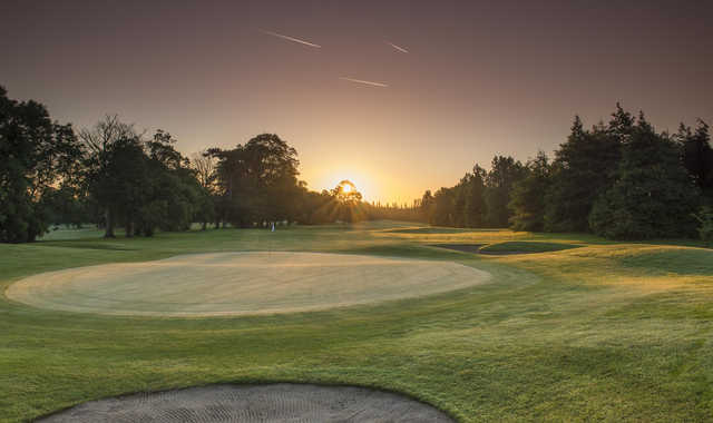 A sunset view of a green at CityWest Hotel and Golf Resort.
