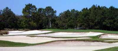 A view of a green protected by bunkers at Old Memorial Golf Club.