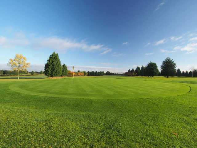 A sunny day view of a green at Bird Hills Golf Centre.