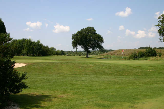 A sunny day view of a hole at Kent & Surrey Golf & Country Club.