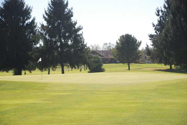 A sunny day view of a green at Carroll Meadows Golf Course.
