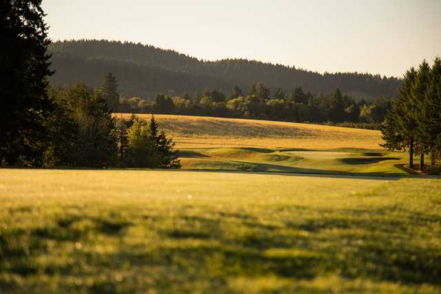A sunset view of a green at Chehalem Glenn Golf Club.