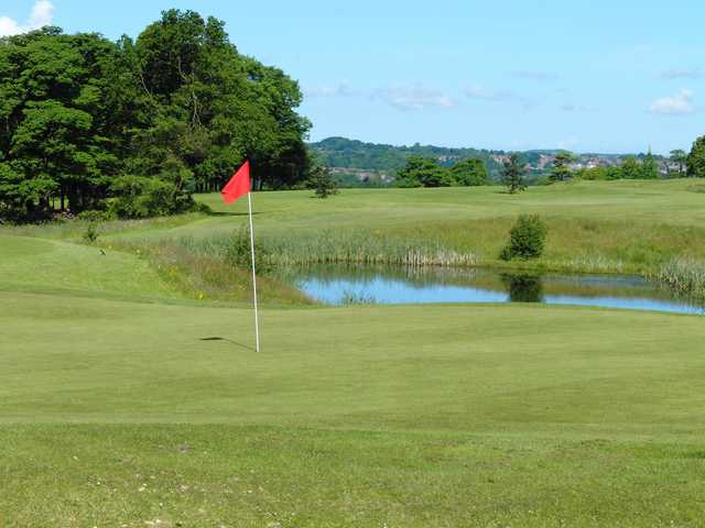 A view of a hole with pond in background at Haigh Hall Golf Club