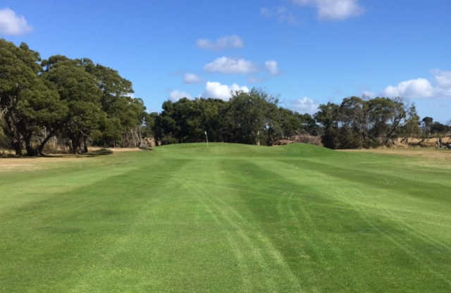 View of a green from the fairway at Bridport Golf Club