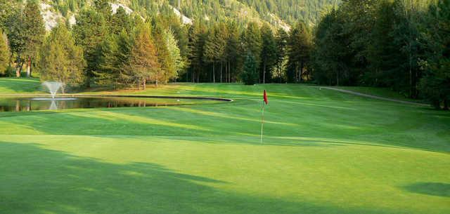 A sunny day view of a hole at Castlegar Golf Club.