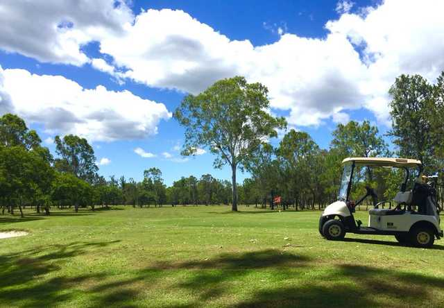 A sunny day view of a hole at Calliope Country Club Golf.
