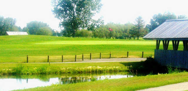 A view over the water of a hole from The Bridges at Claresholm Golf Course.