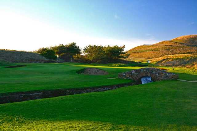 A sunny day view of a hole at Seascale Golf Club.