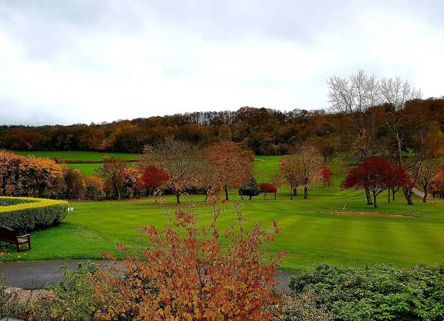 A fall day view of a hole at Wells Golf Club.