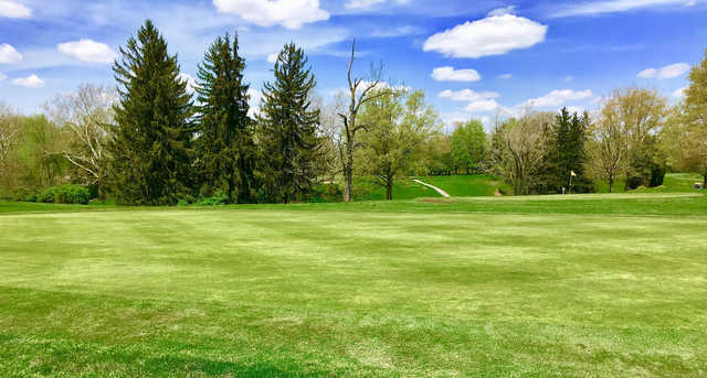 A spring day view of a hole at Golf Club of Bucyrus.