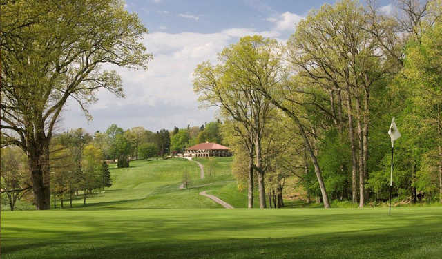 A view of a hole and the clubhouse in the distance at Mount Vernon Country Club.